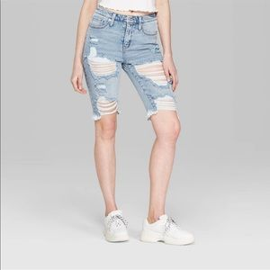 Women's distressed long jean shorts